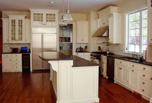 Traditional Kitchen with Gas double oven range, Complex Marble, Inset cabinets, Soapstone counters, Glass panel, L-shaped