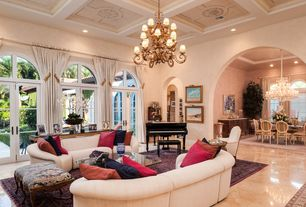 Mediterranean Living Room with Arched doorway, can lights, Box ceiling, Arched window, interior wallpaper, Chandelier