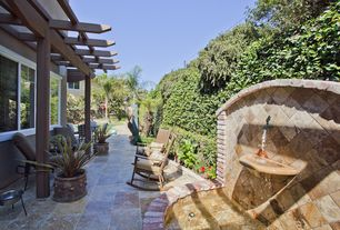 Mediterranean Patio with Pond, exterior stone floors, Raised beds, Pathway, Fence, Trellis