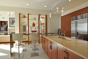 Contemporary Kitchen with Kitchen island, can lights, Framed Partial Panel, six panel door, Corian counters, Breakfast bar