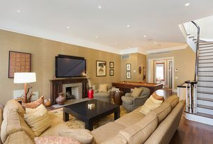 Traditional Living Room with interior wallpaper, Crown molding, Cement fireplace, Hardwood floors