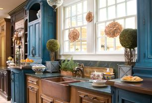 Country Kitchen with limestone tile floors, Farmhouse sink, Slate, Flat panel cabinets, Crown molding, Pendant light