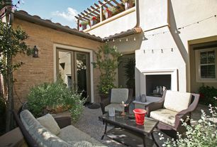 Mediterranean Patio with EDISON BULB STRING LIGHTS, exterior stone floors, French doors, outdoor pizza oven, Trellis