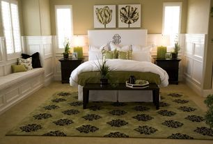 Traditional Master Bedroom with Window seat, Casement, Standard height, Carpet, Paint, Wainscotting