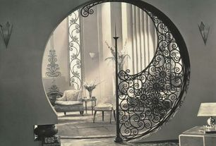 Eclectic Living Room with Concrete floors, Custom wrought iron wall decor, interior wallpaper, Wall sconce, Paint