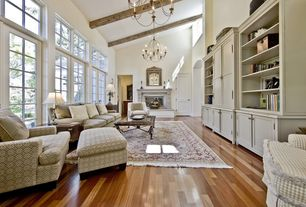 Contemporary Living Room with Cathedral ceiling, Transom window, Chandelier, French doors, Built-in bookshelf, Exposed beam