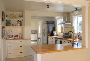Traditional Kitchen with can lights, U-shaped, Wall Hood, gas range, Flat panel cabinets, built-in microwave, Vinyl floors