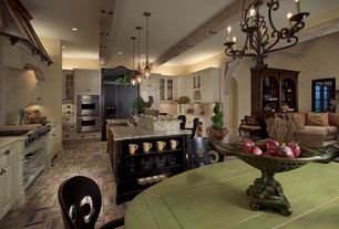 Country Kitchen with Exposed beam, Bronze cup pull, Custom hood, Kitchen island, Viking - double wall oven, Pendant light