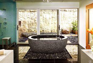Contemporary Master Bathroom with Handheld showerhead, sliding glass door, Standard height, Limestone counters, no showerdoor