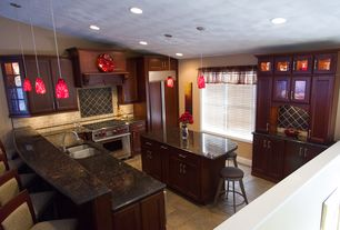 Traditional Kitchen with Breakfast bar, Glass panel, Simple granite counters, L-shaped, limestone tile floors, Stone Tile