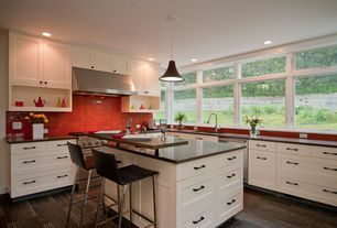 Contemporary Kitchen with Pendant light, Limestone counters, Ann sacks earthenware elements rectangle field, Terracotta Tile