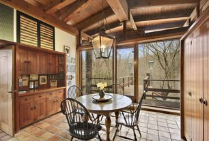 Rustic Dining Room with Exposed beam, Glass panel door, terracotta tile floors, High ceiling, Transom window, Pendant light