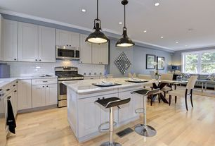 Traditional Kitchen with can lights, built-in microwave, Breakfast bar, Breakfast nook, L-shaped, dishwasher, Hardwood floors