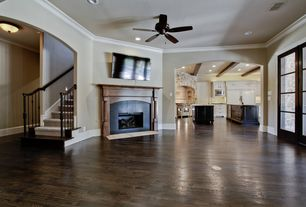 Traditional Living Room with Carpet stair runner, Ceiling fan, Exposed beam, French doors