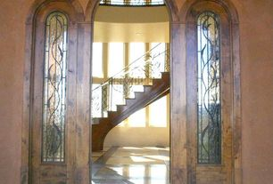 Mediterranean Front Door with exterior stone floors, French doors