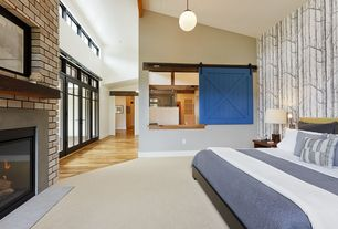 Contemporary Master Bedroom with Pendant light, Built-in bookshelf, Carpet, Anthropologie Wood Wallpaper, High ceiling
