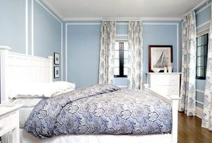 Traditional Guest Bedroom with Laminate floors, Standard height, Casement, Crown molding