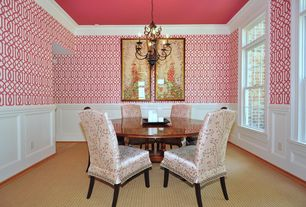 Traditional Dining Room with interior wallpaper, Chair rail, Chandelier, Crown molding, Wainscotting, Carpet
