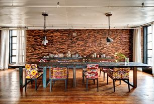 Eclectic Dining Room with Standard height, Exposed brick wall, Pendant light, Upholstered dining chair, picture window