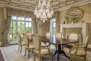 Traditional Dining Room with Hardwood floors, Chandelier, Crown molding, Box ceiling, stone fireplace