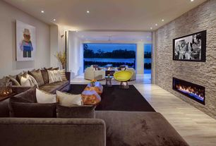Modern Living Room with insert fireplace, Urestone stacked stone #50 antique white stone veneer panel, Laminate floors, Paint
