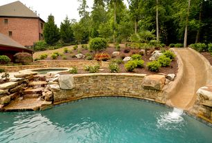 Traditional Swimming Pool with Pool with hot tub, Raised beds, exterior stone floors, Fence