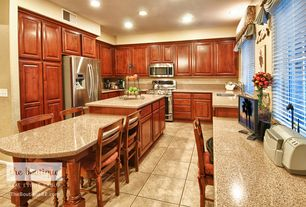 Traditional Kitchen with Simple Granite, stone tile floors, can lights, Raised panel, gas range, Standard height, U-shaped