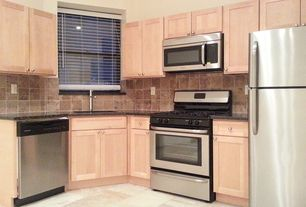 Traditional Kitchen with Stone Tile, built-in microwave, L-shaped, Paint 1, gas range, Simple granite counters, Casement