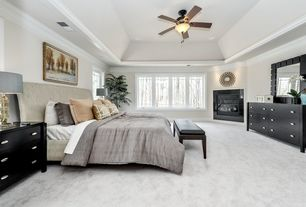 "Traditional Master Bedroom with Crown molding, flush light, 52"" fanimation camhaven bronze finish ceiling fan, Carpet"