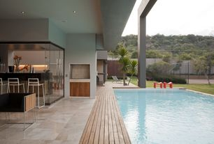 Contemporary Patio with Deck Railing, exterior stone floors, Fence, Lap pool, French doors, picture window, Pathway