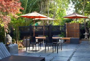 Asian Patio with 9' Ambrosia Market Umbrella, Pathway, exterior stone floors, Heller Mario Bellini Dining Chair, Fence