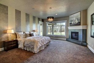 Traditional Master Bedroom with Carpet, Chandelier, Fireplace, Standard height, can lights, French doors, Casement