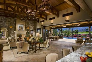 Traditional Great Room with Paint 1, terracotta tile floors, Exposed beam, High ceiling, stone fireplace, Chandelier