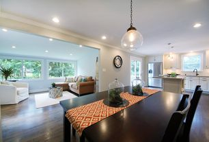 Modern Great Room with Hardwood floors, Crown molding, French doors, Pendant light