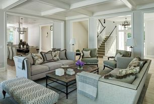 Traditional Living Room with Box ceiling, Columns, Tortoise Fleur-de-Lis Rectangular Coffee Table, Wall sconce, Crown molding