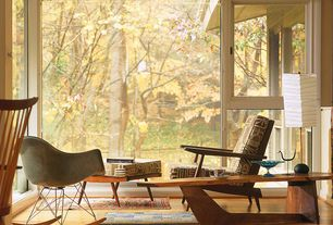 Eclectic Living Room with Laminate floors, Canoe Lounge Chair, George Nakashima Coffee Table, Original