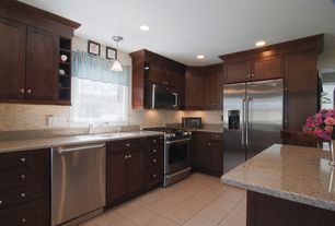 Traditional Kitchen with Flat panel cabinets, dishwasher, can lights, Breakfast bar, L-shaped, built-in microwave, gas range