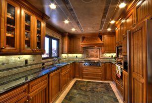 Craftsman Kitchen with limestone tile floors, herringbone tile floors, U-shaped, Ceramic Tile, Glass panel, Sandstone Tile
