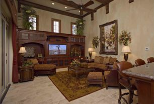 Mediterranean Living Room with High ceiling, travertine tile floors, can lights, stone tile floors, Crown molding, Casement