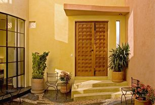 Eclectic Front Door with exterior stone floors, six panel door, picture window