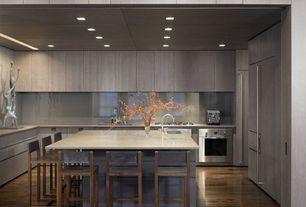Contemporary Kitchen with Undermount sink, Flush, European Cabinets, Limestone counters, Breakfast bar, full backsplash