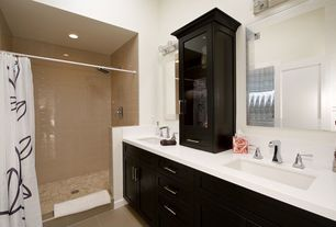 Contemporary Master Bathroom with limestone tile floors, Glass panel, curtain showerdoor, specialty door, High ceiling, Flush