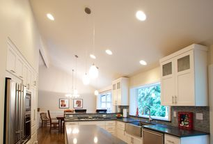 Contemporary Kitchen with can lights, Glass panel, Subway Tile, U-shaped, Pendant light, Multiple Refrigerators, High ceiling