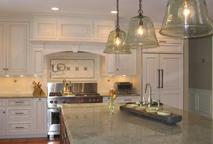 Traditional Kitchen with Pendant light, Simple granite counters, Ms international costa esmeralda granite, Custom range hood