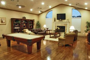 Traditional Living Room with can lights, Pool table, Built-in bookshelf, Hardwood floors, Standard height, Paint, Ceiling fan