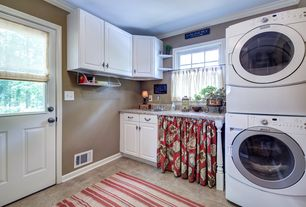 Traditional Laundry Room with laundry sink, Frigidaire front load washer dryer, Standard height, Glass panel door, Casement