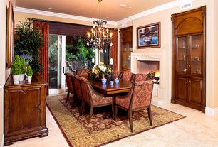 Traditional Dining Room with Glass panel door, travertine floors, Chandelier, Crown molding