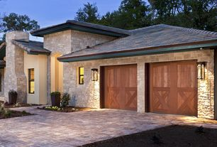 Country Garage with Brick floors, Wall sconce, can lights, Standard height, double-hung window, Barn door
