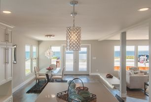 Contemporary Great Room with Pendant light, picture window, Hardwood floors, Standard height, Columns, Sunken living room