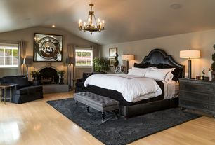 Traditional Master Bedroom with Hardwood floors, Convex clock mirror, stone fireplace, Chandelier